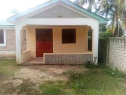Bricked Three Bedroom Bungalow For Sale in Majaoni