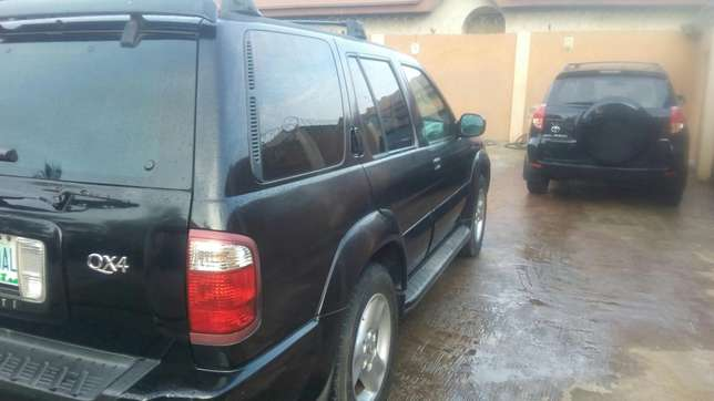 Check this Nissan infinity QX4 out a/c auto drive leather seat alloy Ikeja - image 4