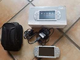 Sony PSP (Portable play station)with case and 19 games