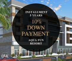 Chalet with sea view and private beach in Aqua Fun Resort