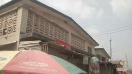 A building on full plot of land for sale at surulere .