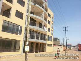 An apartment with offices to rent at kisaasi main road.book now