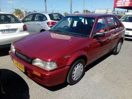 Mazda 323 1.6 1996 on special sale R29000