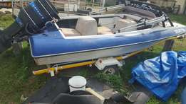 Motorboat with outboard motor.