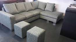 Brand new corner lounge suite with two ottomans from manufacturer