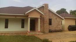 house is located in kitende in a very developed estate on sale