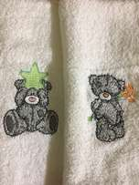 Variety of embroidered burp nappies and face cloths / Spoegdoeke