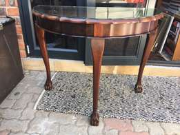 Stunning Imbuia ball and claw half moon table