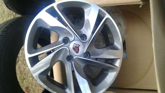 New 14 inch rims and tires for nissan wingroad South C - image 3