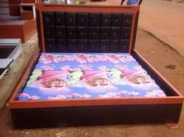 6x6ft bed padded with soft fibre and red burtoned