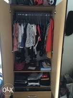 A moderate size wardrobe with a drawer beneath