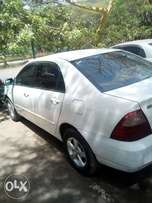 Toyota nze kbQ white auto 1300cc. must sell