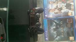 Sony Ps4 with 2 games and 1 remote