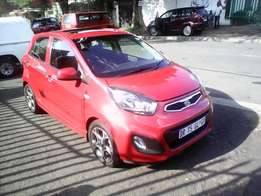 Kia Picanto 1.2, 2012 model, Maroon in color with a sunroof for sale
