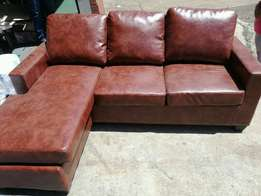 Leather l shaped couch with day bed brand new at cost