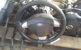Ford Focus steering wheel with airbag for sale.