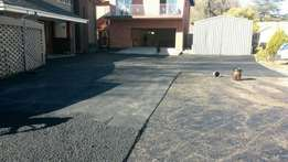 Tar surfacing residential and commercial roads driveways complexes