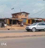 Lucrative half plot with building facing Ejigbo-Isolo road,Lagos N23m