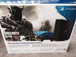 Brand New Sealed Sony PS4 pro 1TB jet black plus 4 games