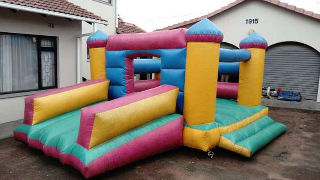 FOR SALE jumping castle 4m x 5m with slide, including blower Margate - image 1