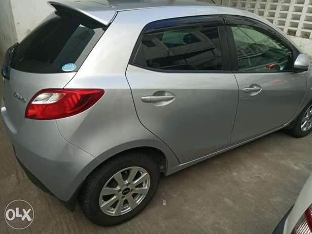 2010 model silver and black Mazda Demio for sale KCP number Mombasa Island - image 3