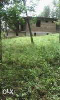 1 (one) Acre with unfinished flat for Sell at Nyarere in Kisii County