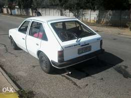 opel kadette running with papers on road 8000