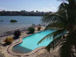 BEACH FRONT 2 bedroom apartment with swimming pool and 24 hrs guards