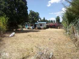 A 50*100 plot of land located at Karunga centre with s house included