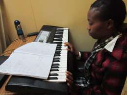 Music-piano, guitar, violin, voice & theory lessons