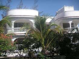 Luxury 6 Bedroom House in Utange with Mature Garden and Fish Pond