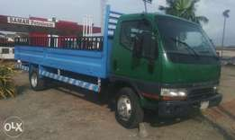 A Mitsubishi Canter pick up Truck (long chassis)