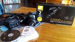 Nikon D3000 and 18-55mm lens, like new, in original box