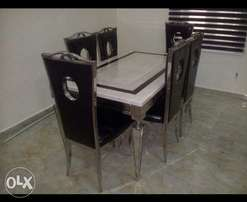 Quality Versace marble dining by six with six chairs