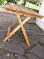Folding, slatted pine table