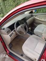 Red 2007 Toyota corolla Tokunbo