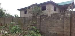 Roofed uncompleted duplex for sale at teslim folarin area in oluyole