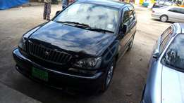 Black Toyota Harrier chases number