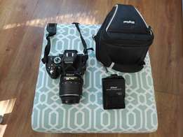 Nikon D5100 Camera with battery charger and pouch