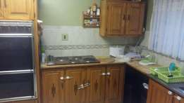 Second hand kitchen cabinets, stove/oven and sink