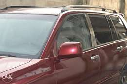 Neatly used full option 04 highlander with 3 seater for sale