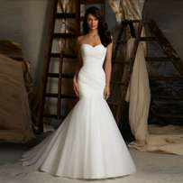 Available in sz 10-16, bridal gowns with attached sleeves and veil