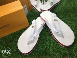 White Louise Vuitton slippers