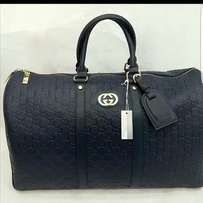 Gucci traveling bags