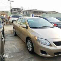 Tin-Can Cleared 2009 Toyota Corolla LE (gold color)