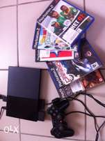 PS2 slim with 5 games