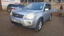 Extrreamly clean silver Nissan X-trail (2008) model with a sun roof.