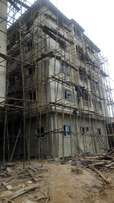 A new 4 story building with 6 flats per floor.
