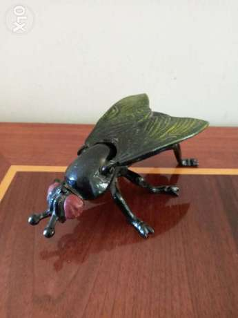 Iron fly mosquito ashtray.