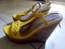 Hot yellow wedge shoe.